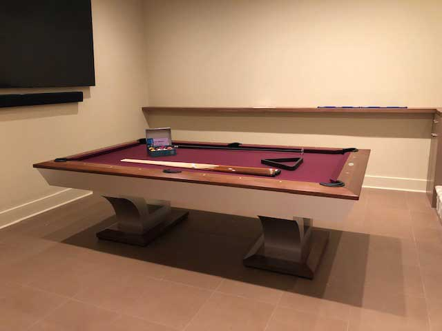 red billiards table in tan room