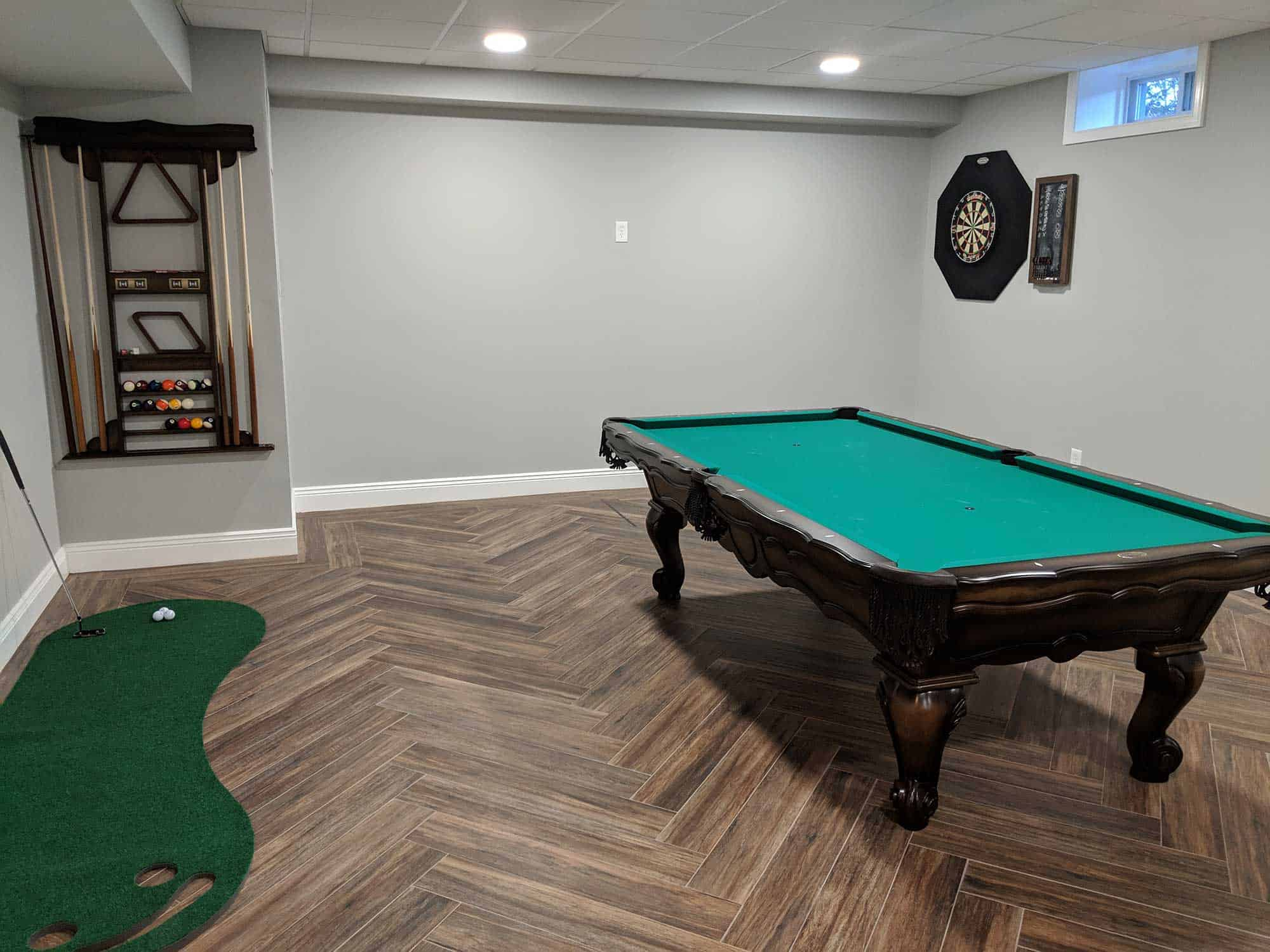billiards room with darts and golf and a cue rack