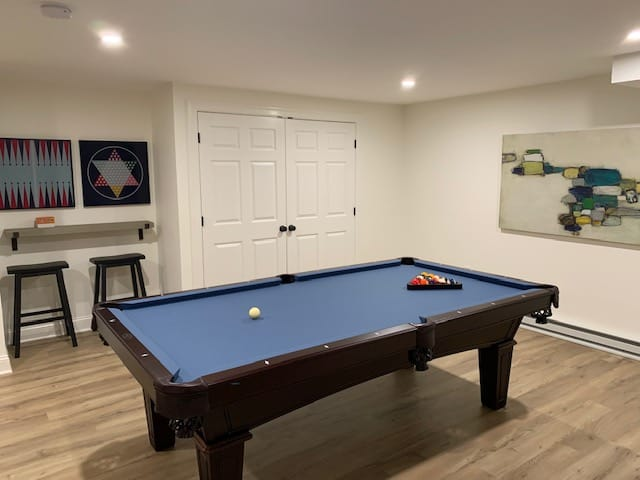 blue pool table in a white room