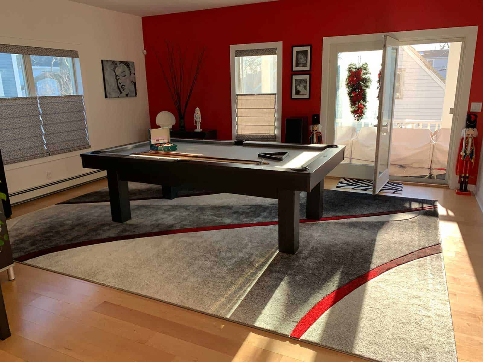 pool table in a red room