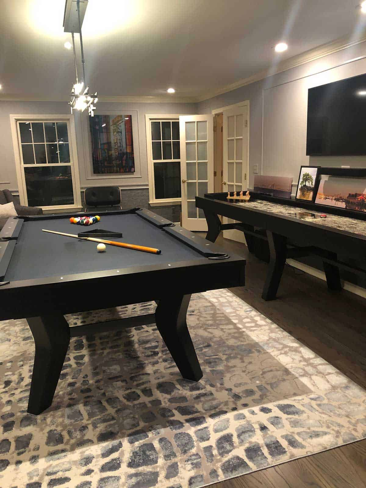 monroe game room with pool table and shuffleboard table