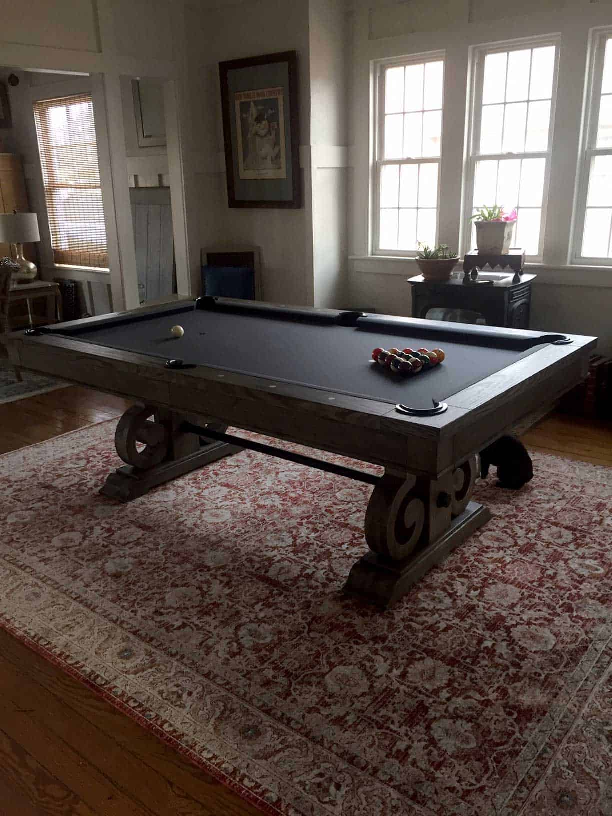 blue pool table on a red rug